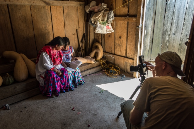 The first traditionally dressed woman we met in Llano Encino. Her granddaughter joined in, sharing a school book with grandma.  Photo by Marina