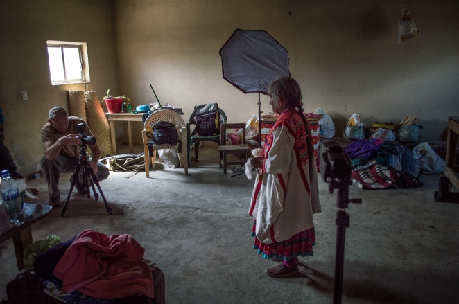 Another traditional woman in Llano Encino and a makeshift studio in her house. She holds cotton that she is preparing to spin.   Photo by Marina