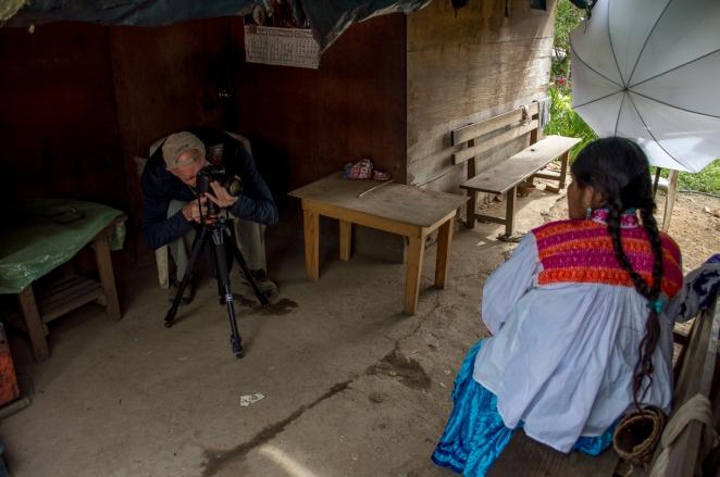 Photographing the sharp-eyed woman of the blue velvet skirt.