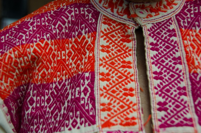 Detail of fine hand-embroidery on muslin cotton